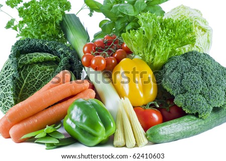 Fresh vegetables and herbs on the white background