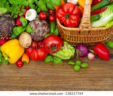 fresh vegetables and herbs on wooden background. raw food. top view - stock photo