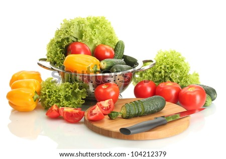 fresh vegetables and knife on cutting board isolated on white - stock photo