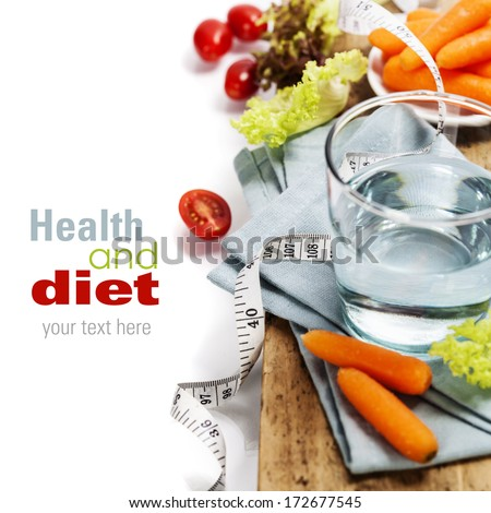 Fresh vegetables and measurement tape - diet and healthy eating concept - over white (with easy removable sample text) - stock photo