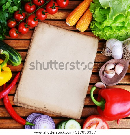 fresh vegetables and olive oil on wooden background - stock photo
