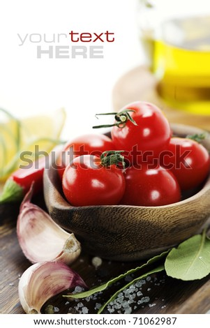 fresh vegetables and olive oil over white. With sample text