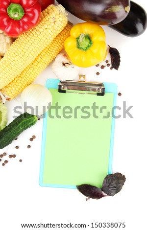Fresh vegetables and spices and paper for notes, isolated on white