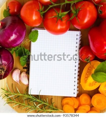 fresh vegetables and spices on the wooden background and paper for notes and recipes - stock photo