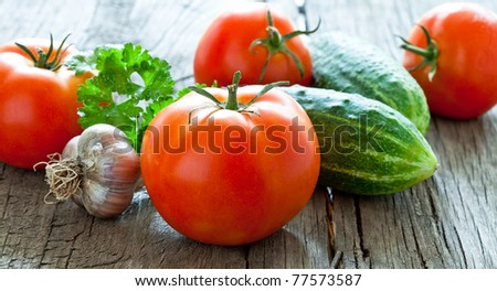 Fresh vegetables close-up on an old table - stock photo