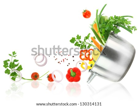 Fresh vegetables coming out from a stainless steel casserole pot - stock photo