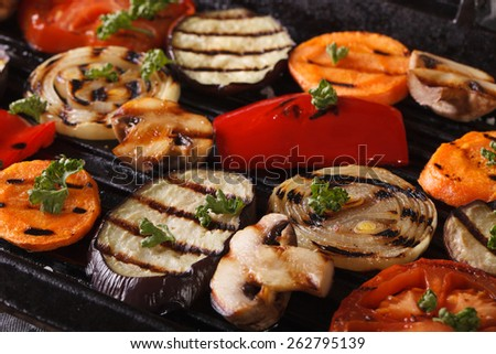 Fresh vegetables cooked in a black skillet grill macro. horizontal  - stock photo