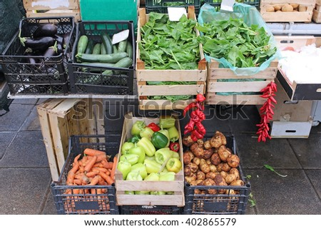 Fresh vegetables crates on green market stall