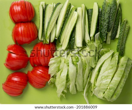 Fresh vegetables: cucumbers, tomatoes and lettuce