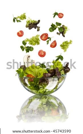 fresh vegetables falling into tho bowl - stock photo