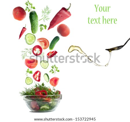 Fresh Vegetables folling in  salad. Isolated on white.