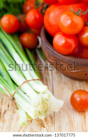 Fresh vegetables for salad, tomatoes and fresh herbs, closeup food - stock photo
