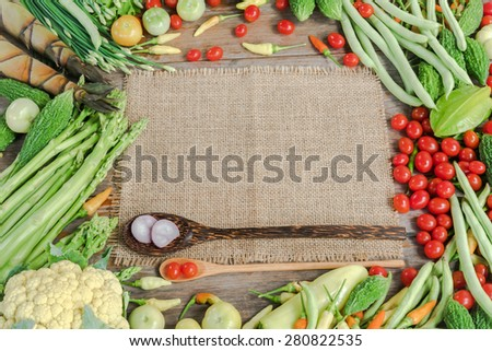 Fresh vegetables frame with textile background
