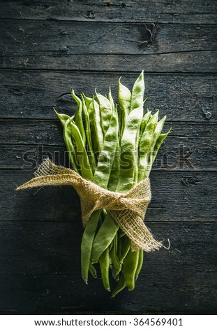 Fresh vegetables. French beans on wood. - stock photo