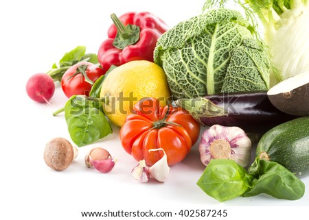 Fresh vegetables from the garden isolated on white - stock photo