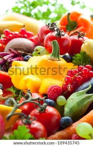 Fresh vegetables,fruits and berries on the white background - stock photo
