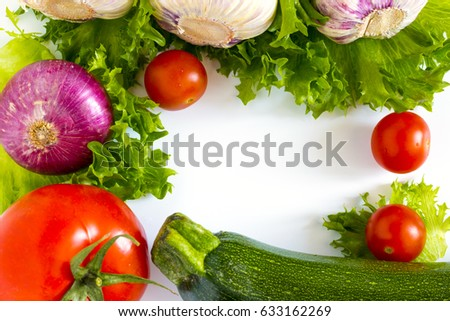 fresh vegetables: garlic, lettuce, tomato, cucumber, onion, zucchini and cherry tomatoes