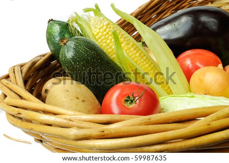 Fresh vegetables in a basket isolated on white background - stock photo