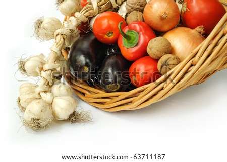Fresh vegetables in a basket on white background - stock photo
