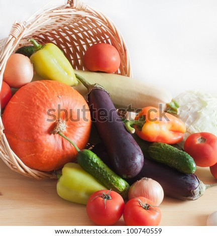 Fresh vegetables in a wicker basket - stock photo
