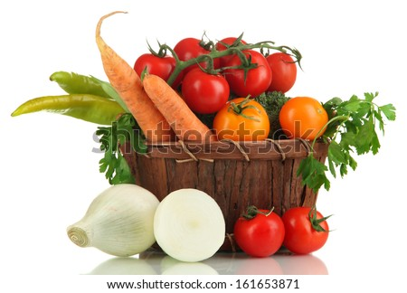 Fresh vegetables in basket isolated on white - stock photo
