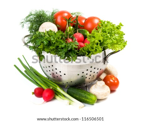 Fresh vegetables in metal bowl on white background
