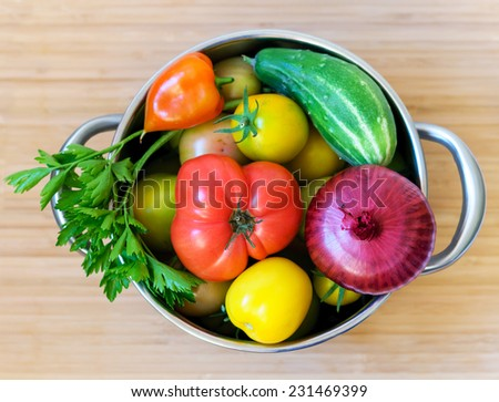 Fresh vegetables in pan - stock photo