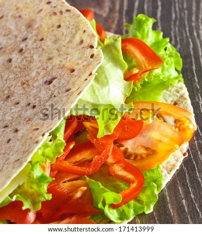 fresh vegetables in pita bread, close up