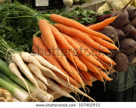 Fresh vegetables in the market; carrots, parsley - stock photo