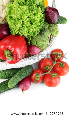 Fresh vegetables in white wicker basket close up