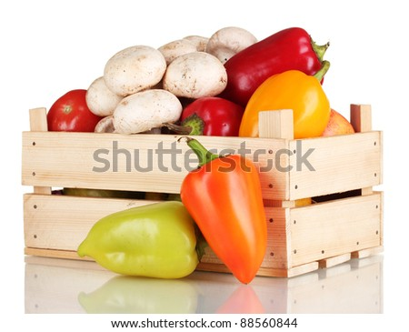 fresh vegetables in wooden box isolated on white - stock photo