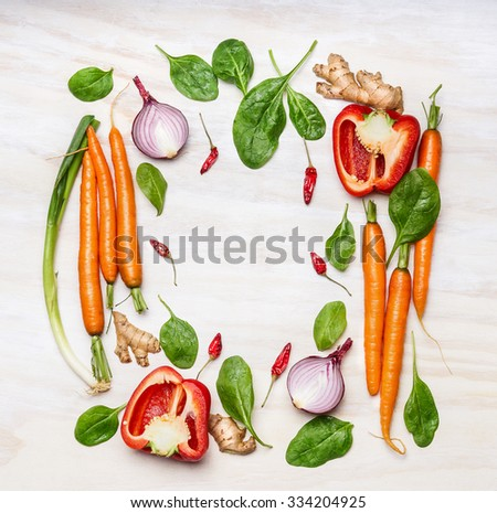 Fresh vegetables ingredients for cooking , composing on white wooden background, top view, frame. Healthy  food, vegetarian or diet nutrition concept. - stock photo