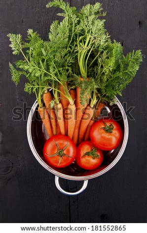 Fresh vegetables into a stainless steel casserole pot - stock photo