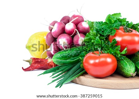 Fresh vegetables isolated on a white background. - stock photo