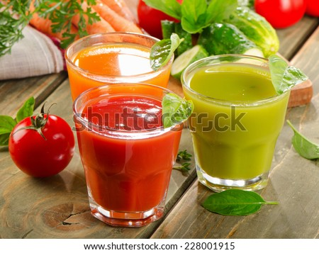 Fresh vegetables  juices on  wooden background. Selective focus