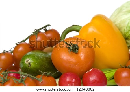 Fresh vegetables like red tomatoes or green cucumber on white