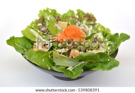 Fresh vegetables, meat and bread salad on black bowl