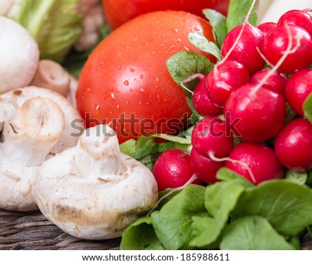 Fresh vegetables mushrooms, tomatoes, leak, cauliflower, lemons, broccoli and pepper,