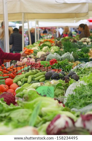Fresh vegetables on a farmers market - stock photo