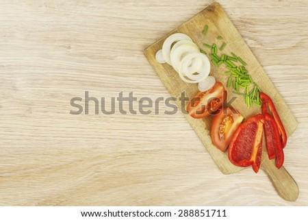 Fresh vegetables on a kitchen cutting board. Homework vegetable salad - stock photo