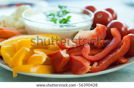 Fresh vegetables on a plate with dipping sauce - stock photo