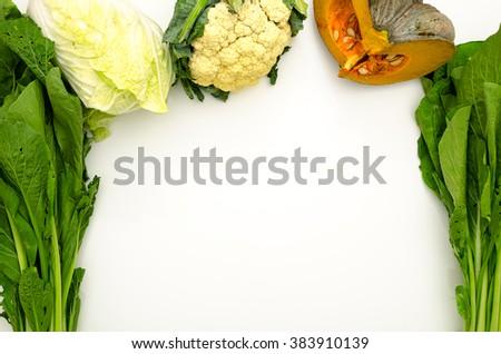 Fresh vegetables on a white background. - stock photo