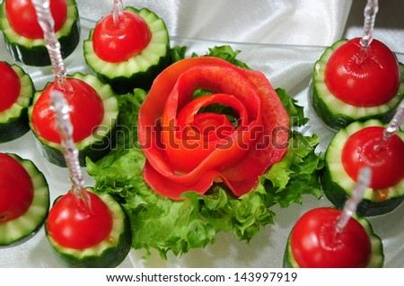 Fresh vegetables on banquet table - stock photo