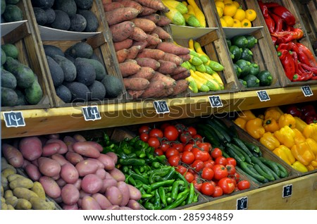 Fresh vegetables on display in farmers market. Food background and texture - stock photo
