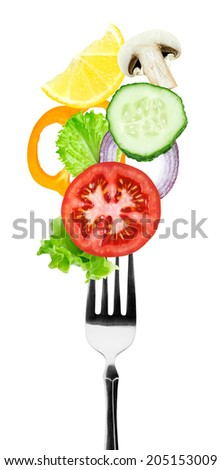 Fresh vegetables on fork. Healthy food