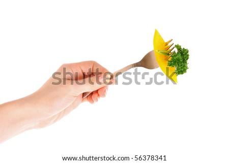 Fresh vegetables on fork isolated on white - stock photo