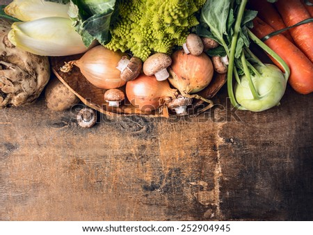 fresh vegetables on old wooden table, food background, top view - stock photo