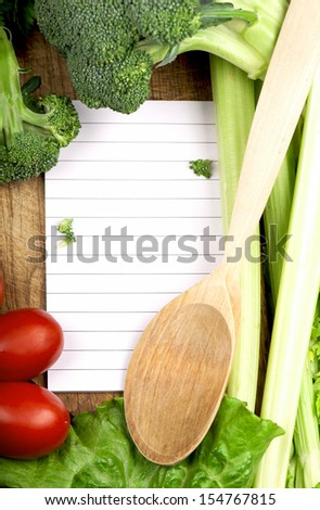 fresh vegetables on the wooden background and paper for notes - stock photo