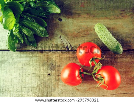 Fresh vegetables on wooden background. Vintage style - stock photo