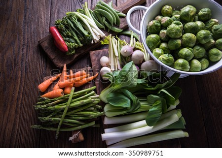 Fresh vegetables on wooden cutting rustic boards